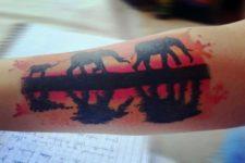 Three elephants tattoo on the arm