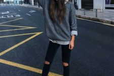 02 black ripped jeans, a striped shirt, a grey oversized sweater, white sneakers and a beanie
