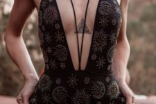 09 a black printed one piece swimsuit with a plunging neckline highlighted with laces