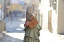 With white shirt, brown bag and heels